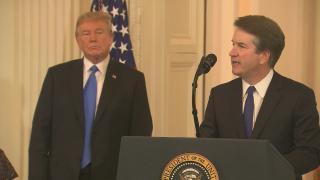 Supreme Court nominee Brett Kavanaugh speaks Monday, July 9, 2018 as President Donald Trump looks on.