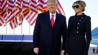 President Donald Trump and first lady Melania Trump look at supporters before boarding Air Force One at Andrews Air Force Base, Md., Wednesday, Jan. 20, 2021. (AP Photo / Manuel Balce Ceneta)