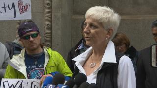Barbara Lloyd of Chicago Rideshare Advocates speaks to the media during a rally Wednesday, May 8, 2019. (WTTW News)