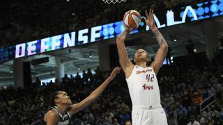 Phoenix Mercury's Brittney Griner (42) shoots against Chicago Sky's Azura Stevens (30) during the first half of Game 4 of the WNBA Finals, Sunday, Oct. 17, 2021, in Chicago. (AP Photo / Paul Beaty)