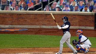 New York Yankees' Clint Frazier, left, watches his two-run home run against the New York Mets during the fourth inning of a baseball spring training game Saturday, July 18, 2020, in New York. (AP Photo / Adam Hunger)