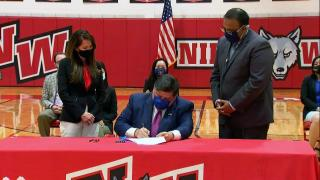 Illinois Gov. J.B. Prtizker signed the Teaching Equitable Asian American History Act on Friday, July 9, requiring public K-12 schools to teach Asian American history. (Pool via CNN)