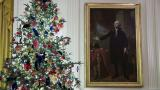 A decorated tree stands next to the portrait of President George Washington in the East Room during the 2019 Christmas preview at the White House, Monday, Dec. 2, 2019, in Washington. (AP Photo / Alex Brandon)