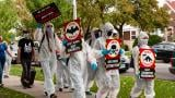 Animal rights activists protest Sunday, Sept. 27 in Belmont Cragin. (Grace Del Vecchio / WTTW News)
