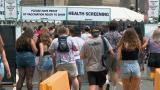 Music fans line up to enter Lollapalooza on the first day of the festival, which returns to Grant Park from July 29 through Aug. 1, 2021. (WTTW News)