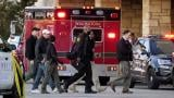 Police officials walk to the Mayfair Mall, Friday, Nov. 20, 2020, in Wauwatosa, Wis. (AP Photo / Nam Y. Huh)