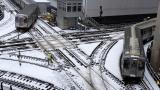 CTA trains move along snow-covered tracks Monday, Jan. 28, 2019, in Chicago. (AP Photo / Kiichiro Sato)