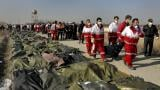 Rescue workers carry the body of a victim of a Ukrainian plane crash in Shahedshahr, southwest of the capital Tehran, Iran, Wednesday, Jan. 8, 2020. (AP Photo / Ebrahim Noroozi)