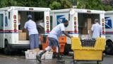 In this July 31, 2020, file photo, letter carriers load mail trucks for deliveries at a U.S. Postal Service facility in McLean, Va. The success of the 2020 presidential election could come down to a most unlikely government agency: the U.S. Postal Service. (AP Photo/J. Scott Applewhite, File)