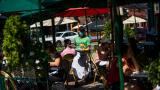 A waiter in a face mask delivers food to the tables outside of a local restaurant during lunch on Friday, Sept. 4, 2020, in Hoboken, N.J. (AP Photo / Eduardo Munoz Alvarez)