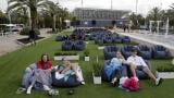 In this Thursday, June 18, 2020 file photo, people sit outdoors to watch a movie as part of a program offered by the Miami Dolphins at Hard Rock Stadium during the coronavirus pandemic in Miami Gardens, Fla. (AP Photo / Lynne Sladky)