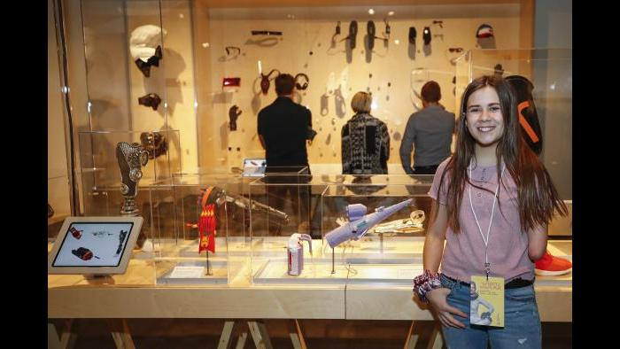 Born without a part of her left arm, 13-year-old Jordan Reeves poses with her 3-D printed prosthetic she created called Project Unicorn – a glitter blasting cannon. (Courtesy MSI Chicago)