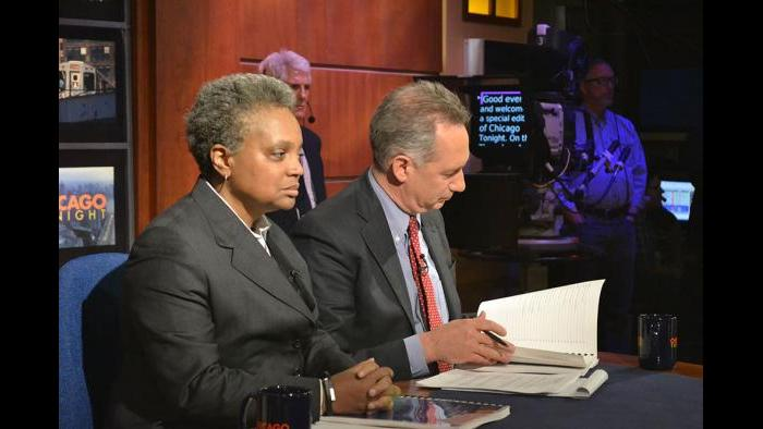 Lori Lightfoot, chair of the Police Accountability Task Force, and Joseph Ferguson, Chicago Inspector General, prepare for the forum.