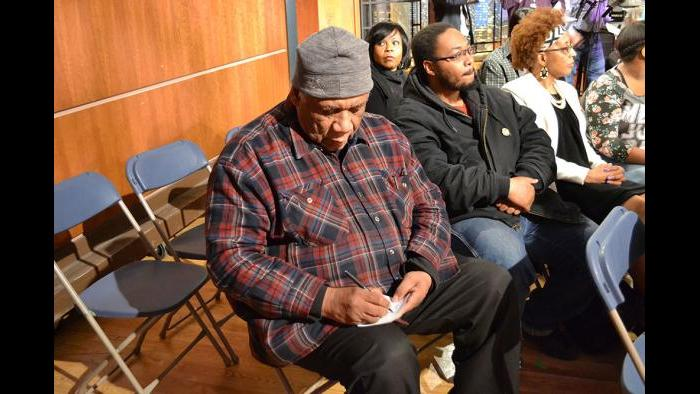 Frank Chapman, field organizer with the Chicago Alliance Against Racist and Political Repression, writes down his question for the forum.