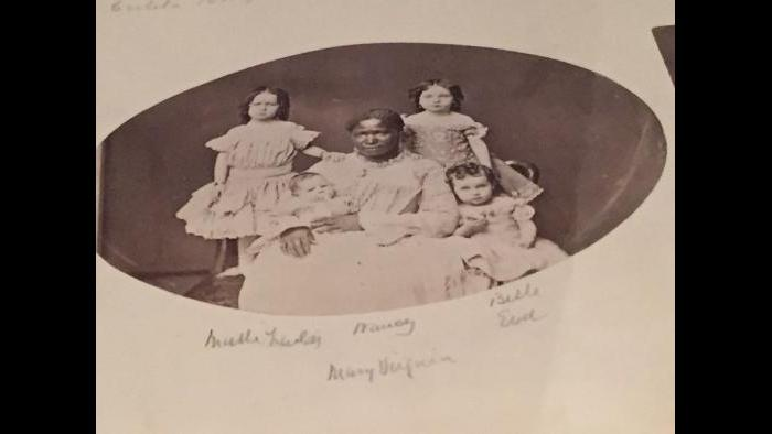 A rare photo of a former slave, Nancy, in her capacity as a nanny in Chicago.