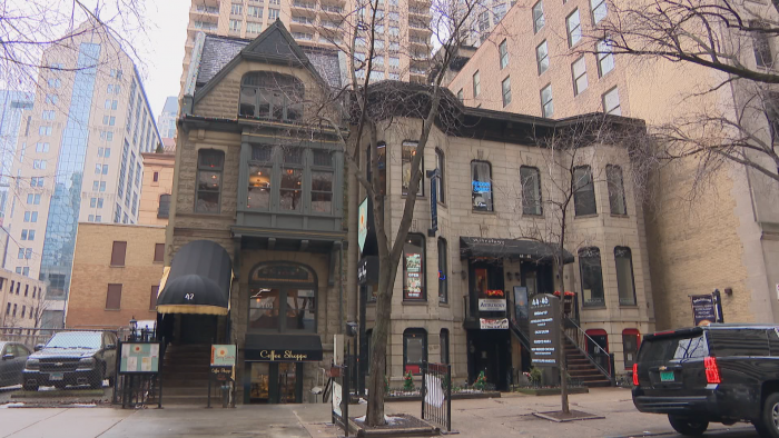 The Queen Anne building at 42 E. Superior St., left, and the Italianate building at 44-46 E. Superior St., right, were at risk of demolition, which triggered the city to review and move to preserve the buildings. (Felix Mendez / WTTW News)