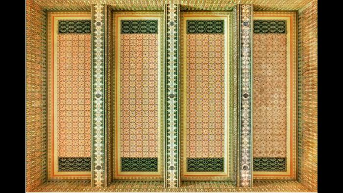 The left three bays of the Trading Room's spectacular ceiling are re-creations while the darker far right panel was pieced together from original fragments.