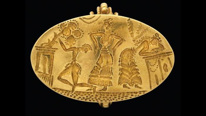 Seal Ring--This ring depicts a religious ritual with a goddess in the center. (National Archaeological Museum, Athens)