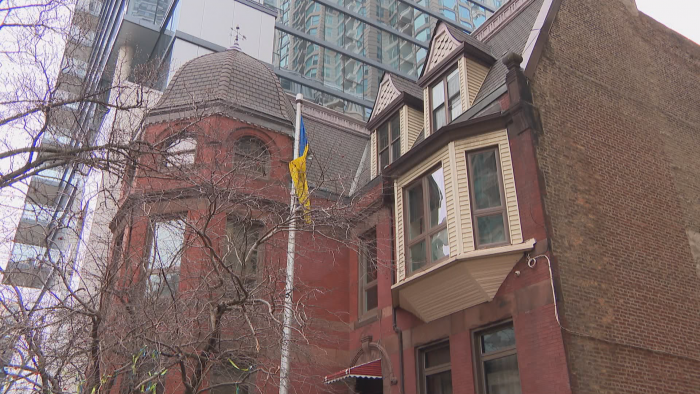 The brick and stone building at 10 E. Huron St. was designed in the Queen Anne style. (Felix Mendez / WTTW News)
