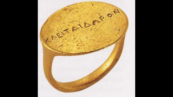 Ring--The inscription on this ring reveals the name of a Macedonian woman who, buried in a tomb among rich objects, was clearly a high-ranking elite. (Archaeological Museum of Thessaloniki)