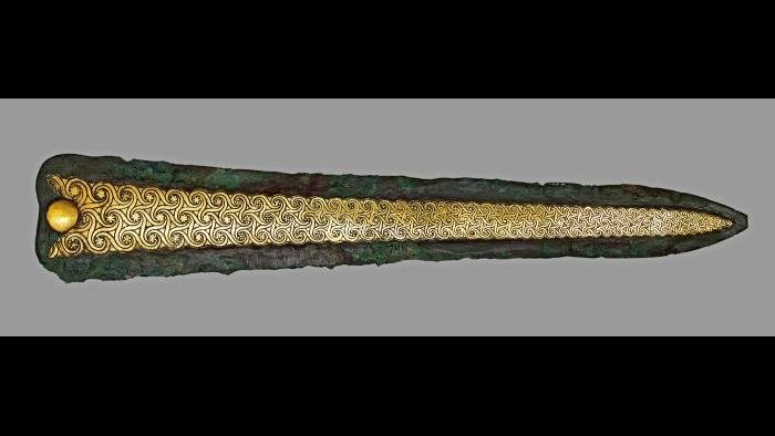 Dagger--A masterpiece of Mycenaean craftsmanship, this dagger features a gold inlaid spiral decoration that is perfectly scaled to the blade's narrowing point. (National Archaeological Museum, Athens)