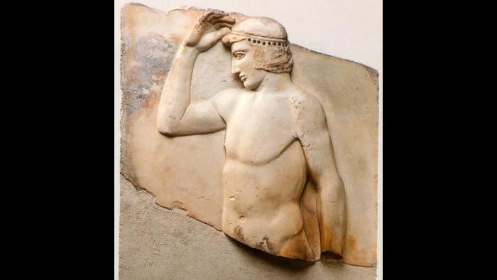 Metaphor for Democracy This relief shows a young athlete placing an olive wreath on his head, which has become a symbol of Athenian democracy. (National Archaeological Museum, Athens)