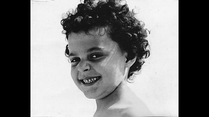 Curls and smiles—Diane as a child. (Courtesy of Diane von Furstenberg)