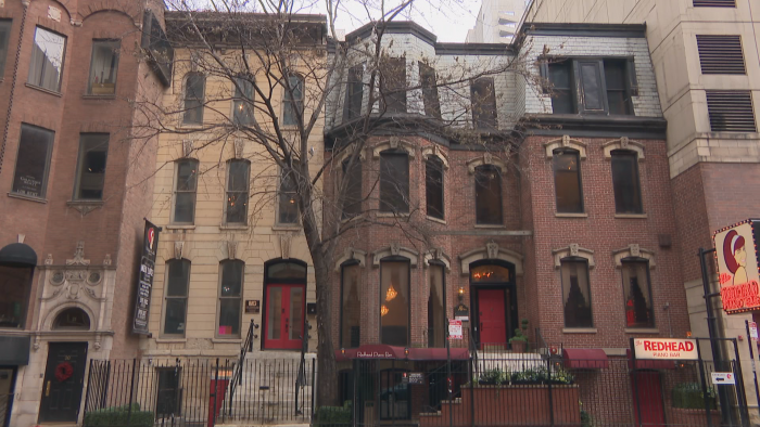 18 W. Ontario St., left, is a limestone Italianate building. 16 W. Ontario St., right, is a brick building in the French-influenced Second Empire style with a mansard roof. (Felix Mendez / WTTW News)