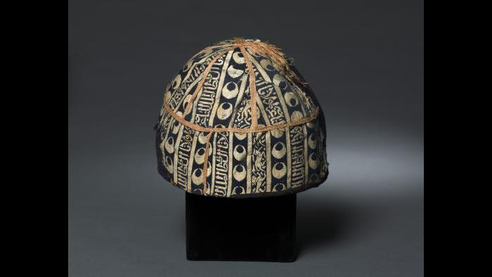 Cap with striped inscribed silk, Egypt or Syria, Mamluk period, probably sultanate of al-Nasir al-Din Muhammad (reigned 1293–1341, with two interruptions), 14th century, Lampas fabric, silk and gold, Cleveland Museum of Art, purchase from the J.H. Wade Fund, 1985.5