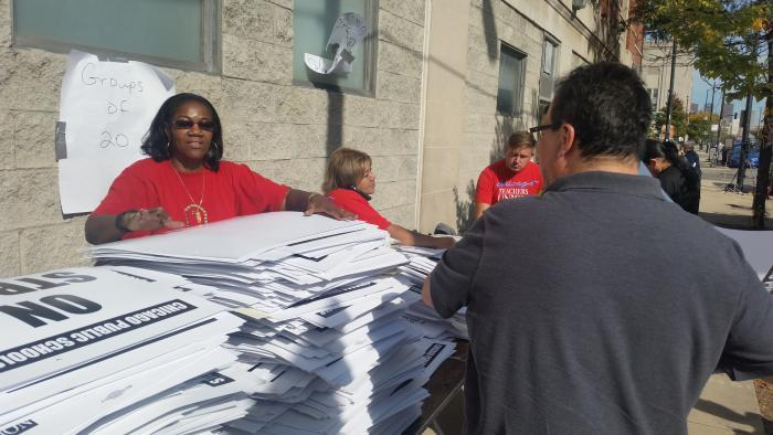 CTU workers distribute strike materials Monday at union headquarters.