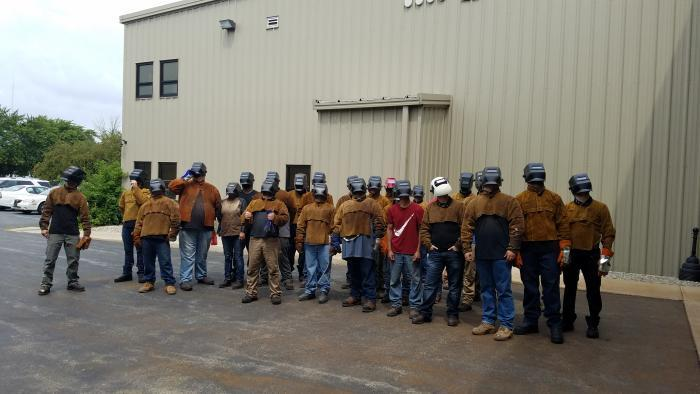 Calumet Welding Center students watching the eclipse. (Submitted by: Renae Alkhovsky)