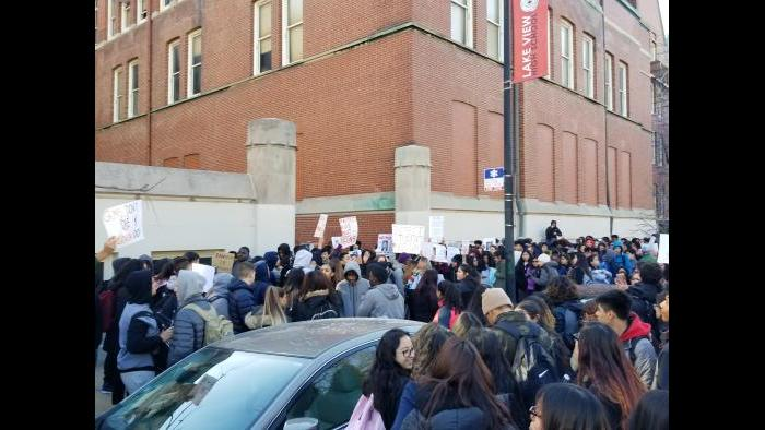 Students march outside Lake View High School. (Matt Masterson / Chicago Tonight)