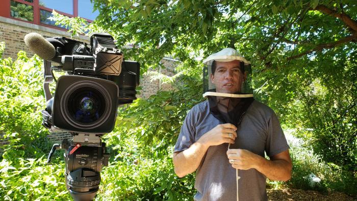Reporting the story: Cameraman Felix Mendez wears protective gear. (Alex Silets / WTTW News)