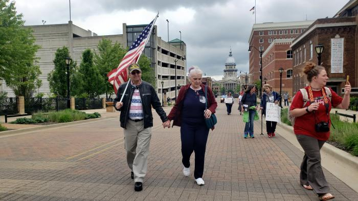 Protesters gather in Springfield on Wednesday, the first day of a special session. (Amanda Vinicky / WTTW News)