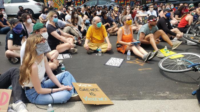 A march on Sunday, June 21, 2020 ends in Wicker Park near the Damen Blue Line CTA stop. (Amanda Vinicky / WTTW News)
