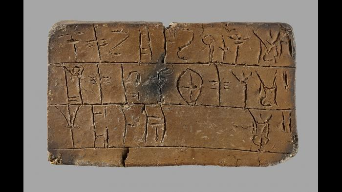Linear B Tablet--For 3,000 years, the symbols that the Mycenaeans carved into clay tablets like this one remained a secret. It was not until 1953 that the script, Linear B, was deciphered, and the words of the Mycenaeans could be read once again. (National Archaeological Museum, Athens)