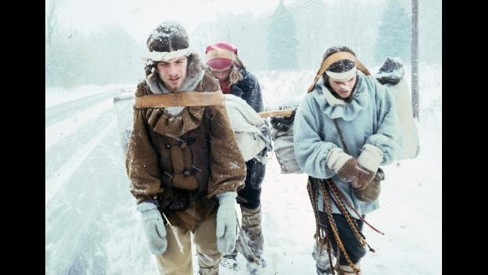 Bob Kulcik, Keith Gorse, and Clif Wilson walk down a snowy road near the Indiana Dunes on December 20, 1976. (Photographers of the La Salle: Expedition II)