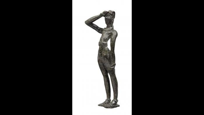 "Male Figurine--This bronze figurine depicts a young worshipper performing the ""Minoan salute"" to engage with the divine. (Archaeological Museum of Herakleion)"
