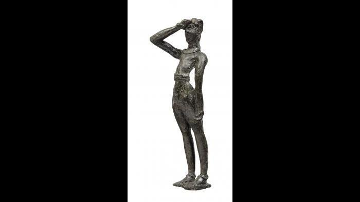 """Male Figurine--This bronze figurine depicts a young worshipper performing the """"Minoan salute"""" to engage with the divine. (Archaeological Museum of Herakleion)"""