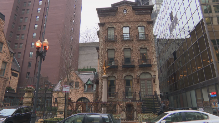 The brick Italianate building at 17 E. Erie St. is owned by businessman and philanthropist Richard Driehaus. (Felix Mendez / WTTW News)