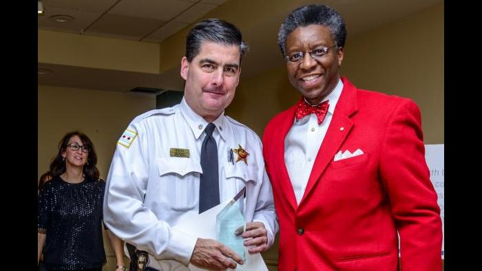 Commander Paul Bauer stands with Randall K. Blakey last December. (Credit: Gordon Walek)