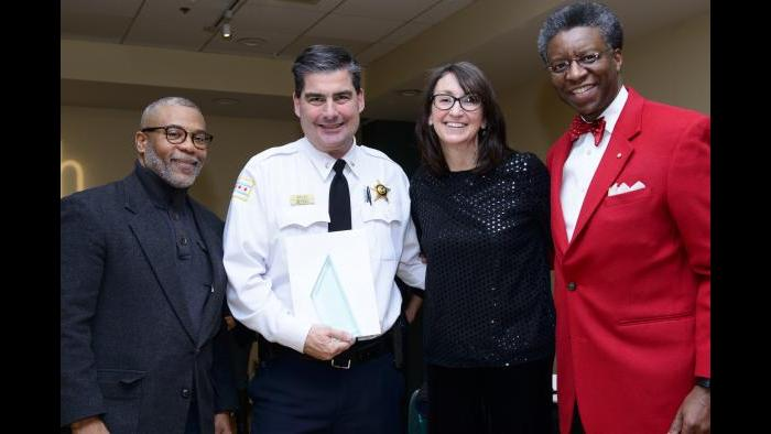 Commander Paul Bauer stands with Randall K. Blakey, far right, last December. (Credit: Gordon Walek)