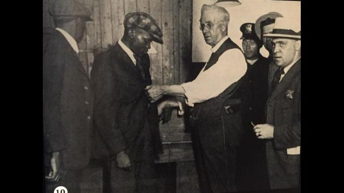 Police officials and community residents during the 1919 Chicago Race Riots.