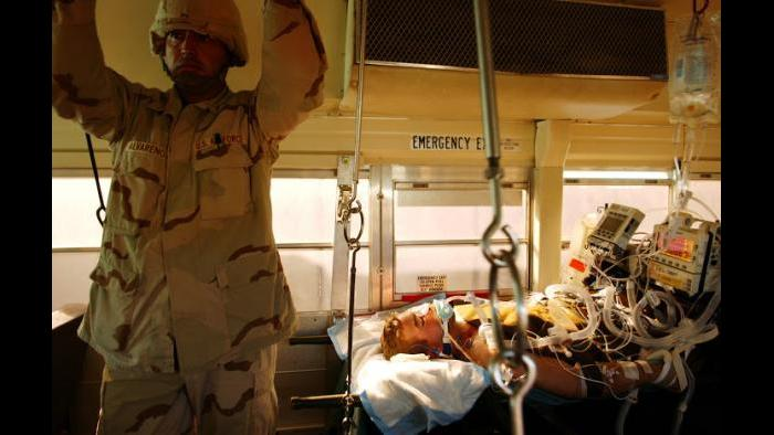 Injured United States soldiers are loaded onto a bus to be taken from the Balad Military Hospital in Iraq. (Lynsey Addario)