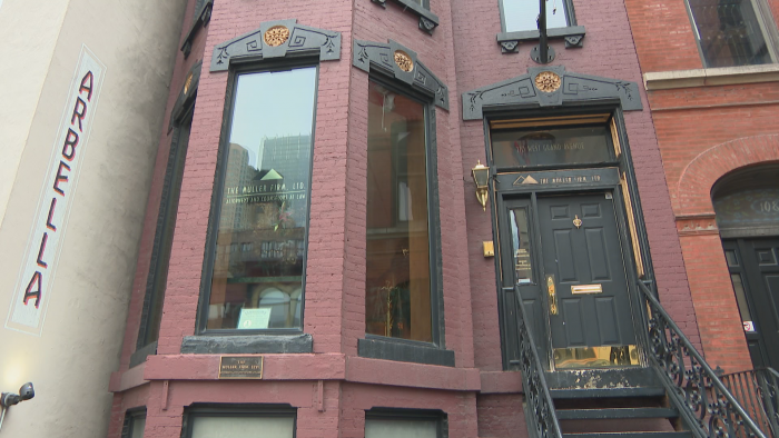 A brick building in the Italianate style at 110 W. Grand Ave. (Felix Mendez / WTTW News)