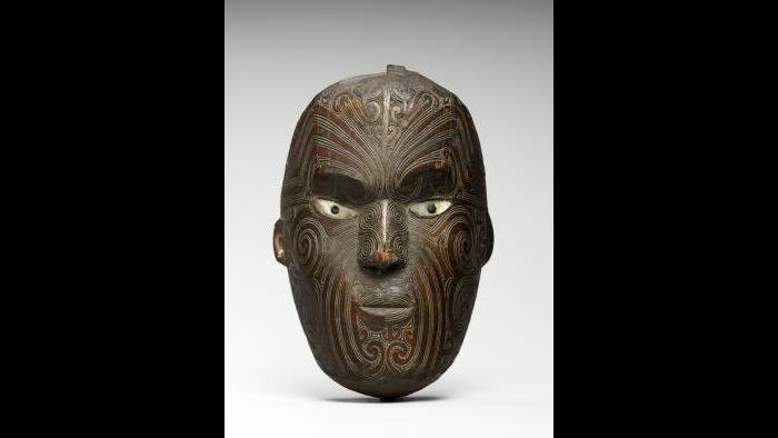Maori mask with facial tattoo design. (Courtesy of The Field Museum)