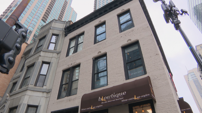 The three-story brick building at 1 E. Huron St. has Italianate-style ornamental features. (Felix Mendez / WTTW News)