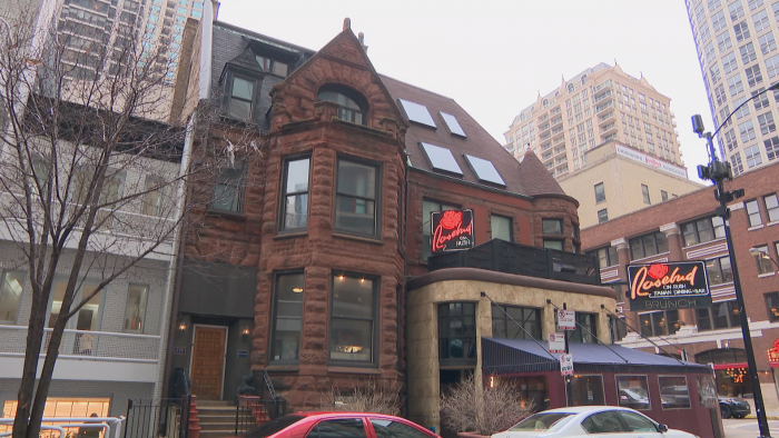 The brownstone at 716 N. Rush St. is a mix of Queen Anne and Romanesque styles. The entryway was remodeled from its original stone arch. (Felix Mendez / WTTW News)
