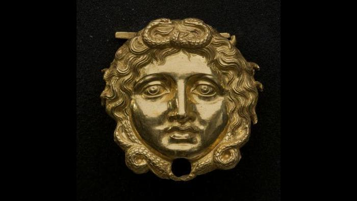Gold Gorgon Head--One of two Gorgon heads that adorned Philip II's linen and leather cuirass, this is one of the earliest and probably the most important surviving examples of this type of adornment. (Museum of the Royal Tombs of Aigai, Vergina)