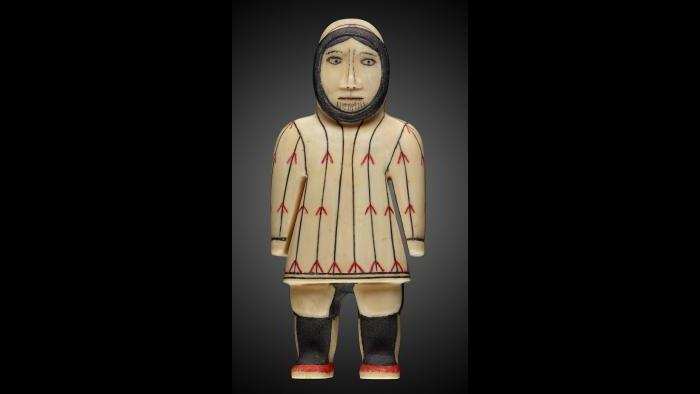 Yupik female figure with chin tattoo. (Courtesy of The Field Museum)